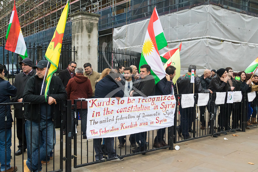 Whitehall, London, December 6th 2015. Supporters of the Kurdish YPG demonstrate outside Downing Street thanking the UK for their support in campaigning against IS/Daesh in Syria and demanding that Turkey, who they accuse of supporting Daesh, is kicked out of Nato.