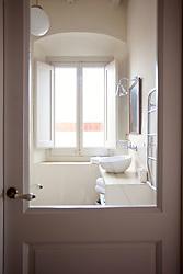 View of Bathroom through Closed Glass Door