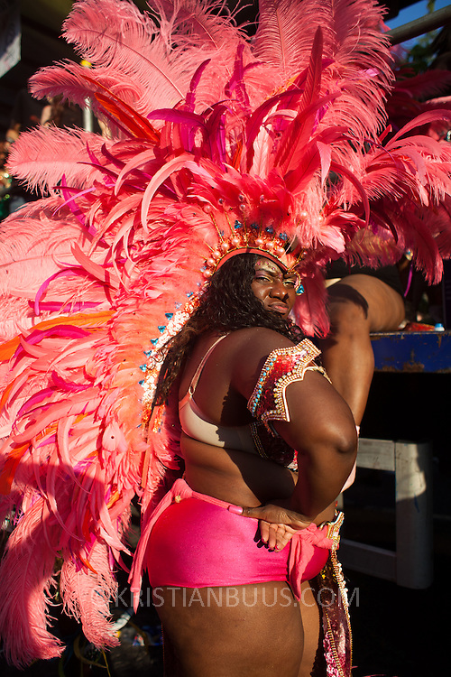 A performer shows of her outfit and moves. The Notting Hill Carnival has been running since 1966 and is every year attended by up to a million people. The carnival is a mix of amazing dance parades and street parties with a distinct Caribbean feel.