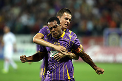 Marcos Tavares and Josip Ilicic of NK Maribor celebrate after their team's first goal during the UEFA Europa League play-offs second leg match between NK Maribor and US Citta di Palermo at Ljudski vrt Stadium on August 26, 2010 in Maribor, Slovenia. Maribor defeated Palermo 3-2 but Palermo won in total 5-3 and qualified for Europa league. (Photo by Marjan Kelner / Sportida)