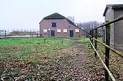 Nederland, Haps, 13-12-2016Een oude boerderij staat leeg en is dicht getimmerd . Het boerenbedrijf wat hier uitgeoefend werd is gestopt . Foto: Flip Franssen