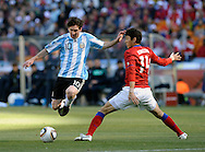 Argentina's  forward Lionel Messi (L) controls the ball past defender Lee Jung Soo of Korea Republic during the World Cup South Africa 2010 soccer match, at Soccer City stadium, in Johannesburgo, South Africa, on June 17, 2010.  (Alejandro Pagni/PHOTOXPHOTO)