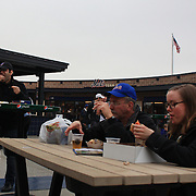 Fans eat fast food during the New York Mets V Arizona Diamondbacks Baseball game at Citi Field, Queens, New York. 5th May 2012. Photo Tim Clayton
