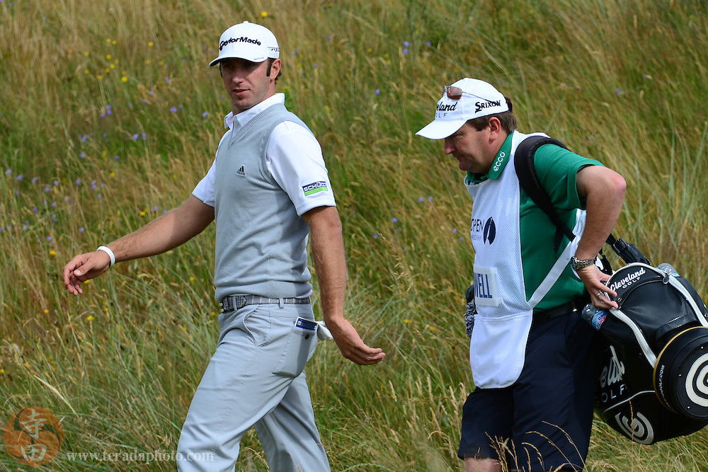 July 20, 2012; St. Annes, ENGLAND; Dustin Johnson (left) walks with Ken Comboy (right), caddy for Graeme McDowell (not pictured), on the 11th hole during the second round of the 2012 British Open Championship at Royal Lytham & St. Annes Golf Club.