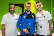 Match sponsor, Specsavers, present a bottle of champagne to man of the match Forest Green Rovers Christian Doidge(9) during the Vanarama National League match between Forest Green Rovers and Guiseley  at the New Lawn, Forest Green, United Kingdom on 22 October 2016. Photo by Shane Healey.