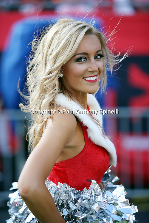 A Tampa Bay Buccaneers cheerleader wears a red and white Christmas outfit during the Tampa Bay Buccaneers 2015 week 14 regular season NFL football game against the New Orleans Saints on Sunday, Dec. 13, 2015 in Tampa, Fla. The Saints won the game 24-17. (©Paul Anthony Spinelli)