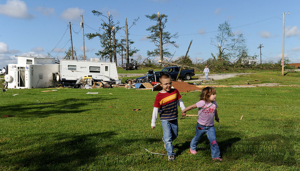 Photo by Gary Cosby Jr.   Residents in Swan Creek, a mobile home community on Highway 31 near Tanner, Ala., recover belongings Thursday, April 28, 2011 left from Wednesday's destructive tornado.  Austen and Aylissa Bohanan walk hand in hand as they explore the rubble near their home searching for things they can salvage.