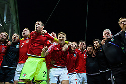 LILLE, FRANCE - Friday, July 1, 2016: Wales players celebrate in the team huddle following a 3-1 victory over Belgium and reaching the Semi-Final during the UEFA Euro 2016 Championship Quarter-Final match at the Stade Pierre Mauroy. head of performance Ryland Morgans, Chris Gunter, goalkeeper Daniel Ward, David Edwards, David Vaughan, Ben Davies, equipment manager David Griffiths, Doctor Rhodri Martin, Mike Murphy. (Pic by David Rawcliffe/Propaganda)