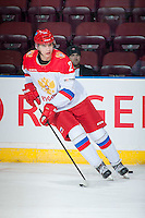 KELOWNA, CANADA - NOVEMBER 9: Ilya Kolganov # 2 of Team Russia warms up with the puck against the Team WHL on November 9, 2015 during game 1 of the Canada Russia Super Series at Prospera Place in Kelowna, British Columbia, Canada.  (Photo by Marissa Baecker/Western Hockey League)  *** Local Caption *** Ilya Kolganov;