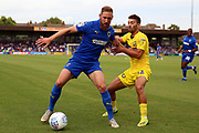 AFC Wimbledon midfielder Scott Wagstaff (7) battles for possession during the EFL Sky Bet League 1 match between AFC Wimbledon and Wycombe Wanderers at the Cherry Red Records Stadium, Kingston, England on 31 August 2019.