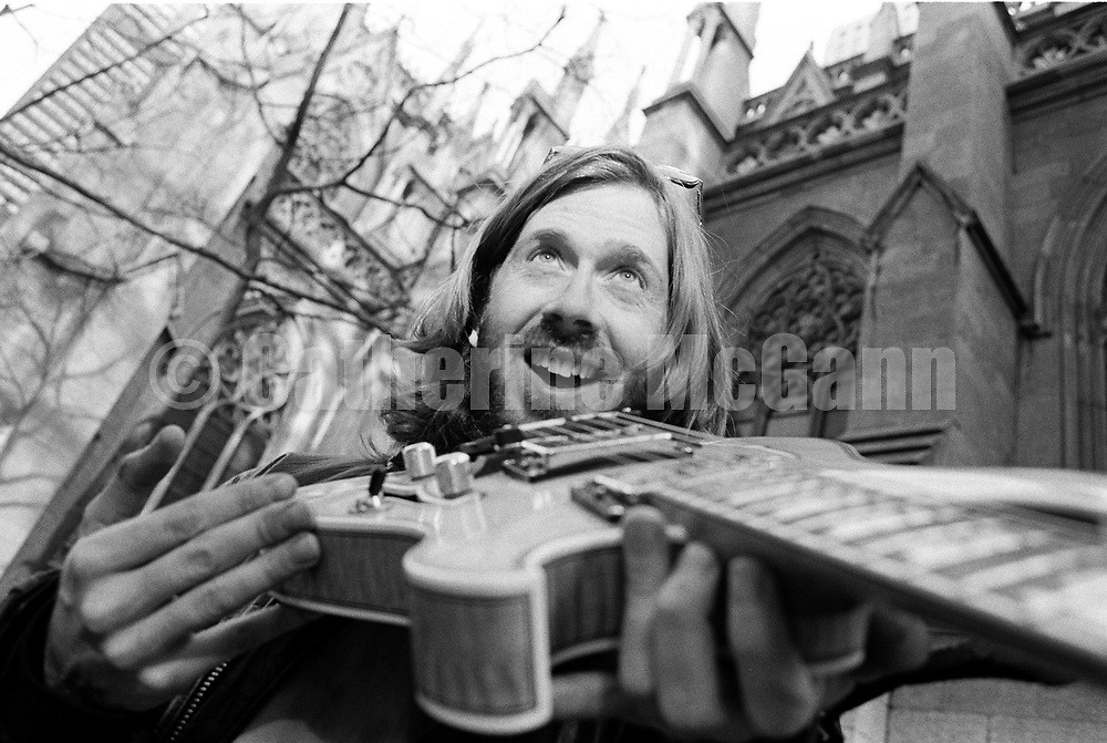 NEW YORK - APRIL 1994:  American musician Trey Anastasio, of the band Phish, poses  for a portrait holding his guitar outside St. Patrick's Cathedral in April 1994 in New York City, New York. (Photo by Catherine McGann).Copyright 2010 Catherine McGann