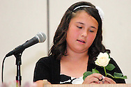Mercedes Cokeley reads a poem during the 8th grade recognition ceremony at Cleveland PK-8 School in Dayton, May 25, 2012.