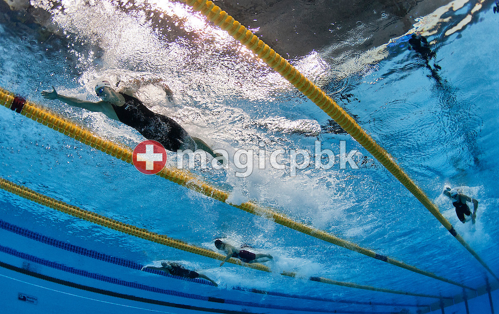 Amanda Weir (L) of the United States of America (USA) swims on the freestyle leg in the women's 4x100m Medley Relay Heats during the 14th FINA World Aquatics Championships at the Oriental Sports Center in Shanghai, China, Saturday, July 30, 2011. (Photo by Patrick B. Kraemer / MAGICPBK)