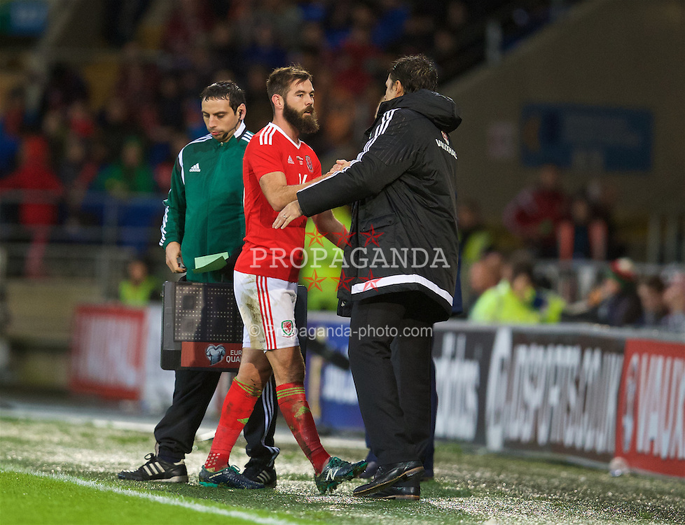 CARDIFF, WALES - Friday, November 13, 2015: Wales' Joe Ledley is substituted by manager Chris Coleman against the Netherlands during the International Friendly match at the Cardiff City Stadium. (Pic by David Rawcliffe/Propaganda)