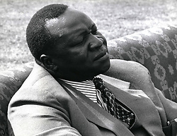 Dec. 12, 1968 - Uganda celebrates eleven years of Independence: The Ugandan people recently celebrated the eleventh anniversary of Independence. Since 1971 the country has been rules by President Idi Amin Dada who told the people in an Anniversary speech that they had achieved more in their few years of Independence than in the seventy years they had spent under British Colonial rule. Photo shows seated in a comfortable arm-chair, general Amin watches a parade staged to celebrate Uganda's Independence Anniversary at Kamapala's Nakivubu Stadium.  (Credit Image: © Keystone Pictures USA/ZUMAPRESS.com)