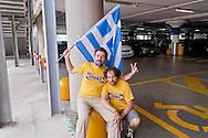 Roma 11 luglio 2015<br /> Sciopero nazionale dei dipendenti  IKEA, di tutti i 21 negozi in Italia, è il  primo sciopero nazionale  organizzato dai lavoratori della multinazionale svedese dell'arredamento. I manifestanti lamentano tagli in busta paga e tagli sulla retribuzione nei giorni festivi. I lavoratori Ikea Anagnina. Un manifestante con la bandiera della Grecia.<br /> Rome 11 July 2015<br /> National strike of the employees 'IKEA, of  all 21 stores in Italy, is the first national strike organized by the workers of the multinational Swedish furniture. Protesters complain about cuts in payroll and wage cuts on public holidays. Workers Ikea Anagnina. A protester with the flag of Greece