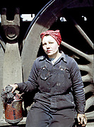 Fascinating Color Portrait Photos of Women Railroad Workers During WWII<br /> <br /> World War II began when Hitler's army invaded Poland on September 1, 1939. However, it wasn't until the day after the Japanese attacked Pearl Harbor on December 7, 1941, that the United States declared war on the Axis Powers.<br /> <br /> The railroads immediately were called upon to transport troops and equipment heading overseas. Soon the efforts increased to supporting war efforts on two fronts-- in Europe and in the Pacific.<br /> <br /> Prior to the 1940s, the few women employed by the railroads were either advertising models, or were responsible primarily for cleaning and clerical work. Thanks to the war, the number of female railroad employees rose rapidly. By 1945, some 116,000 women were working on railroads. A report that appeared on the 1943 pages of Click Magazine regarding the large number of American women who had stepped forward to see to it that the American railroads continued to deliver the goods during the Second World War:<br /> <br />     &quot;Nearly 100,000 women, from messengers aged 16 to seasoned railroaders of 55 to 65, are keeping America's wartime trains rolling. So well do they handle their jobs that the railroad companies, once opposed to hiring any women, are adding others as fast as they can get them...&quot;<br /> <br /> In April 1943, Office of War Information photographer Jack Delano photographed the women of the Chicago &amp; North Western Railroad roundhouse in Clinton, Iowa, as they kept the hulking engines cleaned, lubricated and ready to support the war effort.<br /> <br /> Photo shows: Mrs. Marcella Hart, mother of three, a wiper at the roundhouse.<br /> &copy;Library of Congress/Exclusivepix Media