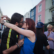 Lovers kiss in Portobello Road. The Notting Hill Carnival has been running since 1966 and is every year attended by up to a million people. The carnival is a mix of amazing dance parades and street parties with a distinct Caribbean feel.