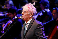 John Cale performing 'Life along the borderline: A tribute to Nico and Paris 1919 with conductor Jeffrey Milarsky and The Wordless Music Orchestra at BAM on January 18, 2013..Photo Credit ; Rahav Iggy Segev / Photopass.com