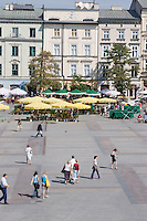 People walking on the Rynek in Krakow Poland
