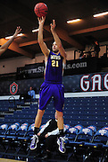 November 28, 2011; Moraga, CA, USA; San Francisco State Gators forward Griffin Reilly (21) shoots the ball during the first half of the Shamrock Office Solutions Classic consolation game against the Jacksonville State Gamecocks at McKeon Pavilion.