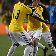 James Rodriguez, Colombia, pushes away team mate Freddy Guarín after scoring the winning goal during the Colombia Vs Canada friendly international football match at Red Bull Arena, Harrison, New Jersey. USA. 14th October 2014. Photo Tim Clayton