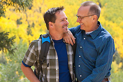 mature man and a middle aged man enjoying time together while hiking in the Santa Fe Mountains during The Fall season
