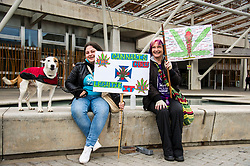 Pictured: Honey (10) Nicole Dickson (25) and her mother Marianne Dickson (42) whose placard is covered on both sides by the many diseases helped by medicianal cannabis picked up from the FaceBook page CBDusersuk@facebook<br /> Protesters gathered outside the Scottish Parliament while they waited on colleagues in meeting with MSPs and health car professionals who were putting forward the case to legalise medicinal cannabis.  Most had first hand experience of the benefits of using the drug under medical supervision.<br /> <br /> <br /> Ger Harley | EEm Date