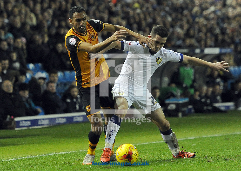 Lewis Cook of Leeds United fights for the ball with Ahmed Elmohamady of Hull City during the Sky Bet Championship match at Elland Road, Leeds<br /> Picture by Graham Crowther/Focus Images Ltd +44 7763 140036<br /> 05/12/2015