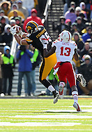 November 23 2012: Iowa Hawkeyes tight end C.J. Fiedorowicz (86) pulls in a pass as Nebraska Cornhuskers safety P.J. Smith (13) defends during the first half of the NCAA football game between the Nebraska Cornhuskers and the Iowa Hawkeyes at Kinnick Stadium in Iowa City, Iowa on Friday November 23, 2012. Nebraska defeated Iowa 13-7 in the Heroes Game on Black Friday.