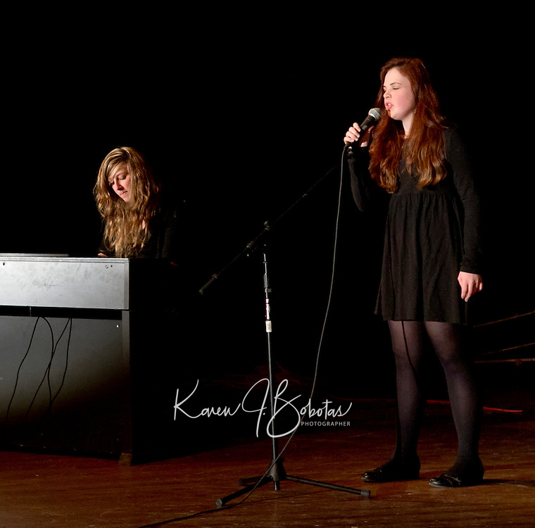 "The duo of Hailey Miles and Gwen Huot  perform Miles' song ""Mirrors"" for the Laconia High School Teacher/Student Talent Show Thursday evening.  (Karen Bobotas/for the Laconia Daily Sun)"