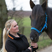 Janine Mason pictured at her farm near Coupar Angus in Perthshire, with 'Spirit' one of the horses she has rescued from a horse rescue charity in Portugal...19.03.15<br /> Picture by Graeme Hart.<br /> Copyright Perthshire Picture Agency<br /> Tel: 01738 623350  Mobile: 07990 594431