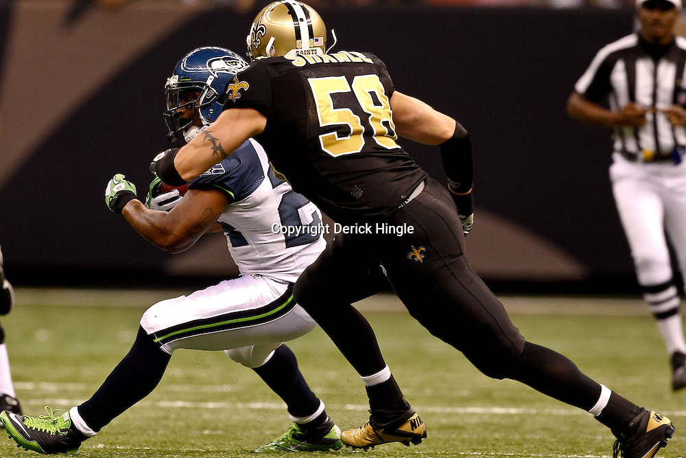 November 21, 2010; New Orleans, LA, USA; New Orleans Saints linebacker Scott Shanle (58) pursues Seattle Seahawks running back Marshawn Lynch (24) during the second half at the Louisiana Superdome. The Saints defeated the Seahawks 34-19. Mandatory Credit: Derick E. Hingle