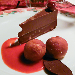Three layer chocolate death, fresh fried donut holes filled with pastry cream over strawberry puree. Dinner at RSVP Restaurant in West Cornwall Connecticut April 2016
