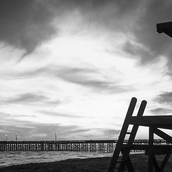 Newport Beach Lifeguard Tower B black and white panorama photo. Newport Beach is a popular coastal beach city along the Pacific Ocean in Orange County Southern California. Panorama photo ratio is 1:3.  Copyright ⓒ 2017 Paul Velgos with All Rights Reserved.