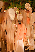 Les Mangeurs de Poussiere, or The Dust Eaters, sculptural and video installation by Nathalie Demaretz, May/June 2015, exhibited at the La Place Gallery, as part of the LOOP Festival, Barcelona, Spain. The installation consists of figures made from plaster masks draped with clothes and with film projected onto their backs. The work explores the theme of exile, inspired by tales of migrants and the movement of peoples across the globe. The figures were displayed inside the gallery and outside in the streets. Picture by Manuel Cohen