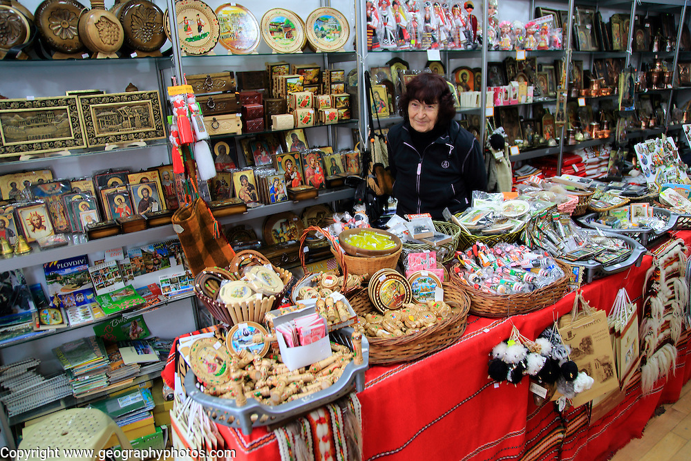 Woman shopkeeper standing in her souvenir gift shop, Plovdiv, Bulgaria, eastern Europe