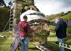 © Licensed to London News Pictures. 03/05/2018. Chalton, UK. The head of a 30 foot high Wickerman is prepared to be put in place ahead of The Beltain Festival at Butser Ancient Farm in Hampshire. Over two thousand people will gather on Saturday 5th May to witness the ancient Celtic celebration of summer - which will culminate in the burning of the giant Wickerman. Photo credit: Peter Macdiarmid/LNP