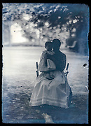 portrait of mother with a toddler on a glass plate France ca 1910s