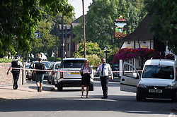 © Licensed to London News Pictures. 25/08/2019. SOUTHALL, UK.  Detectives at the scene adjacent to St Mary's Avenue near Southall in west London.  It is reported that a man in his 60s was stabbed outside The Plough pub (pictured right) on Tentelow Avenue in the early evening of 24 August and stumbled to nearby St Mary's Avenue to seek aid from a residence.  Police were called at 6.41pm, paramedics and air ambulance crews attended but the man passed away.  A man in his 30s has been arrested on suspicion of murder.  The investigation continues. Photo credit: Stephen Chung/LNP
