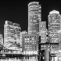 Boston skyline panorama black and white photo with Boston Harbor, downtown Boston skyscrapers and Northern Avenue Bridge. Panorama photo ratio is 1:3.