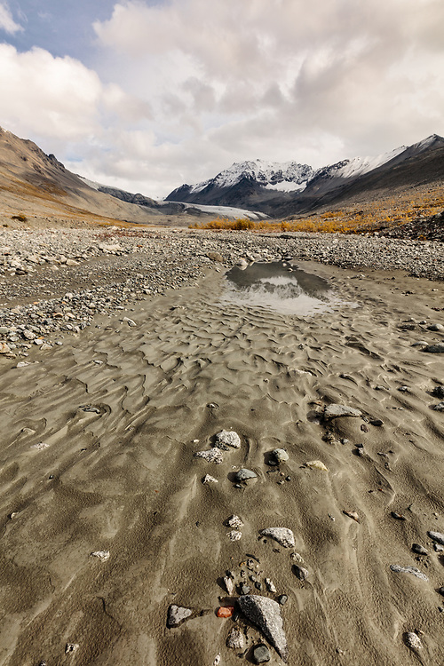 Silt from glacial melt forms patterns near the terminus of Gulkana Glacier near Paxson in Interior Alaska. Autumn. Afternoon.
