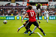 Tammy Abraham of Swansea City is tackled my Phil Jones and Daley Blind of Manchester United during the Premier League match between Swansea City and Manchester United at the Liberty Stadium, Swansea, Wales on 19 August 2017. Photo by Andrew Lewis.