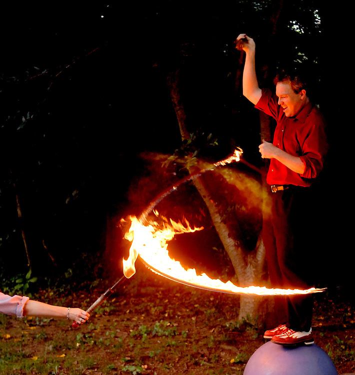 (staff photo by Matt Roth)..Greg May says he has never seen a clown dance through a flaming lasso before, not to say it's never been done. He has completely developed this trick on his own. ..