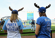 Kansas City Royals fans Lisa Brooks, left, and her sister, Amber Brooks, right, wear moose hats in honor of the player, Mike Moustakas before the Royals game against the Tampa Bay Rays at Kauffman Stadium in Kansas City, Mo., Tuesday, April 30, 2013.  (AP Photo/Colin E. Braley)