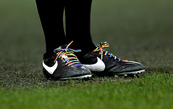 An assistant referee wearing rainbow laces as part of the Stonewall campaign