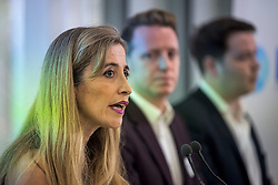 © Licensed to London News Pictures. 19/02/2018. London, UK. L to R SANDRA KHADHOURI, (head of communications), JAMES CLARKE (head of outreach) and JAMES TORRANCE (head of strategy) speaking at the launch event for Renew, a new anti-Brexit political party, at the Queen Elizabeth II Conference Centre in London. The Renew party, which is taking advice from representatives of Emmanuel Macron's En Marche, has recruited some 220 candidates to stand in local and national elections. Photo credit: Ben Cawthra/LNP