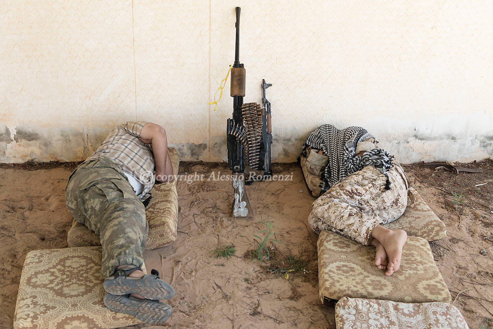 Libya: Libya's Government of National Accord's (GNA) fighters take some rest on the frontline with ISIS in Sirte. Alessio Romenzi