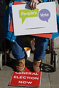 On the day that MPs in Parliament vote on a possible delay on Article 50 on EU Brexit negotiations by Prime Minister Theresa May, an activist demands a general election during a protest outside the House of Commons, on 14th March 2019, in Westminster, London, England.