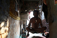 Rahm exercises yoga, a ritual he performs every morning, in his room. Varanasi, India.